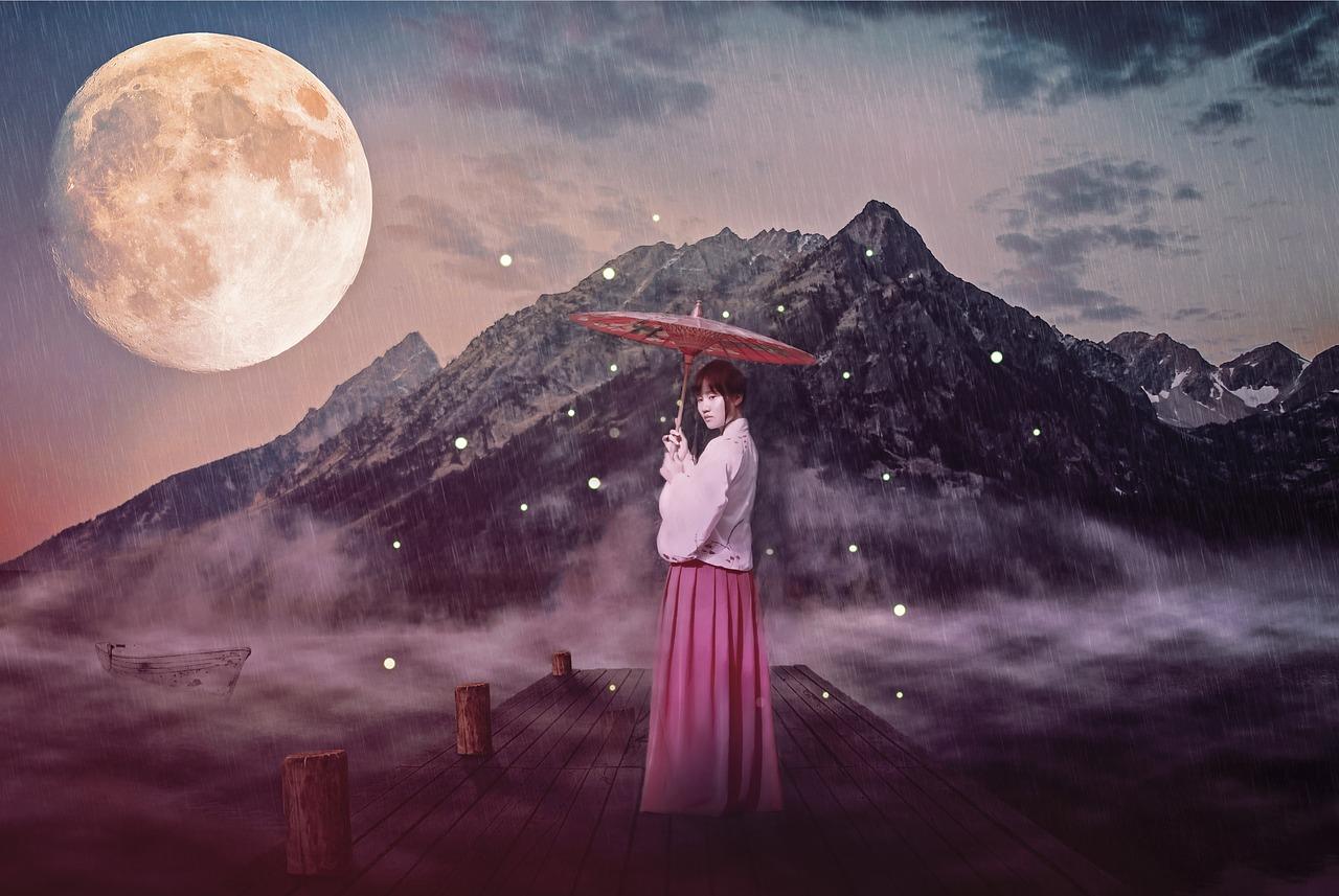 女性と月と傘